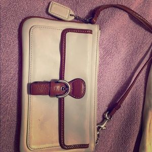 Like new COACH wristlet cream/camel leather.
